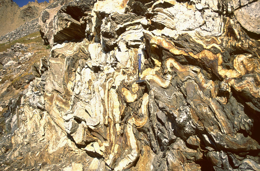 Serious forces caused the folding of these Archean metamorphic rocks.